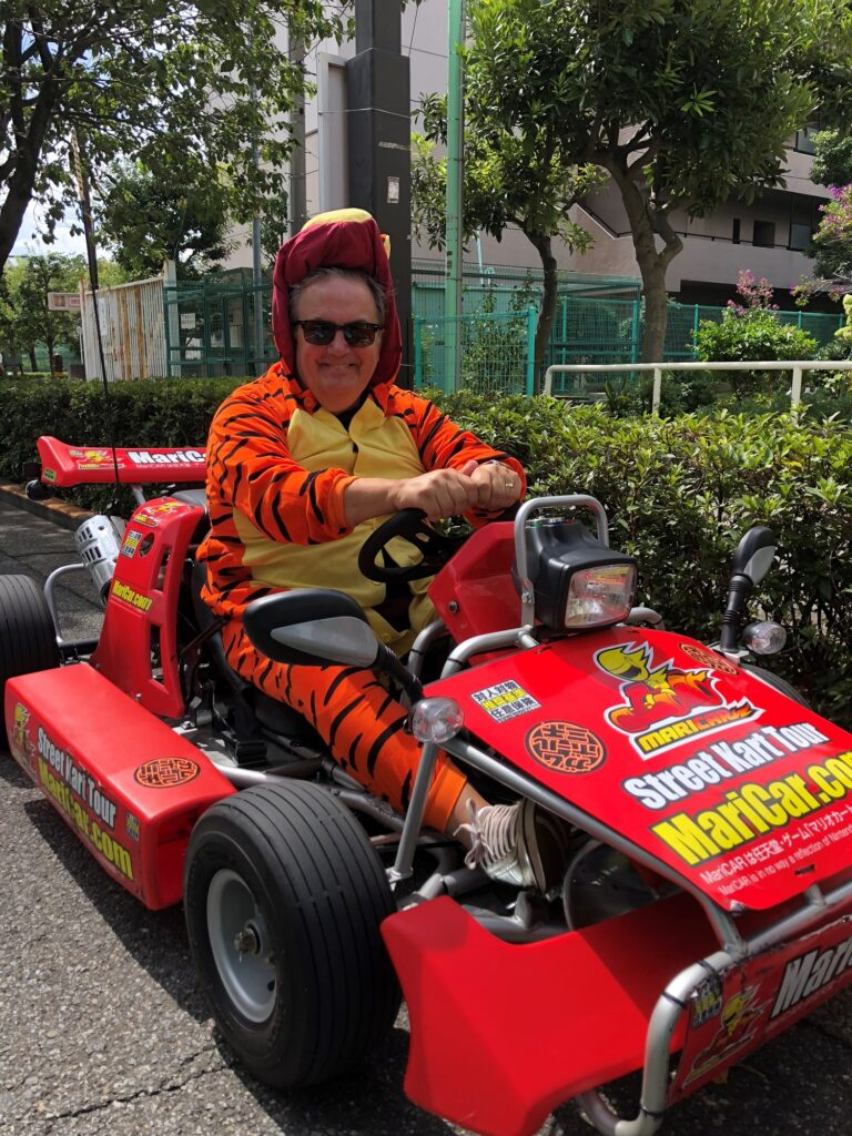 Director Peter Jackson on a go-kart